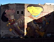 Sunny mural in Lodz.. A large mural on the building in the center of Lodz Stock Photo