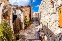 Sunny narrows on a summer day in the village of Lofou. Limassol Royalty Free Stock Photography