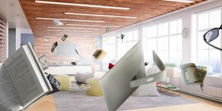 Sunny office with objects flying around. Flying office objects inside sunny office royalty free stock images