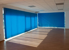 Sunny office room. Empty office room with blue blinds Royalty Free Stock Photos