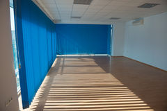 Sunny office room. Empty office room with blue blinds and air-conditioning Stock Image