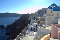 Sunny Oia,Santorini. Picture taken at Oia,Santorini,Greece-amazing,heavenly place.This azure blue sea and sky and the dazzling white houses were things that most Stock Photography