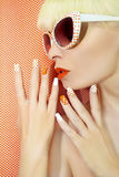 Sunny orange manicure and makeup. stock images