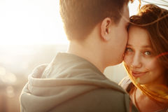 Sunny outdoor portrait of young happy couple Stock Photos