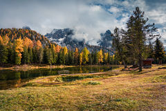 Sunny outdoor scene on Antorno lake. Colorful autumn morning in Dolomite Alps, National Park Tre Cime di Lavaredo, Italy, Europe. Artistic style post processed stock photos