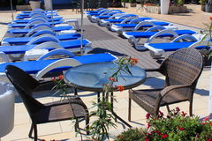 Sunny outdoor sunbeds and patio furniture Royalty Free Stock Photo