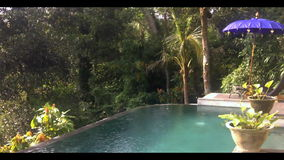 Sunny outdoor swimming pool located on the edge of stock footage