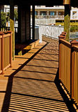 Sunny path with wooden railing Stock Photo