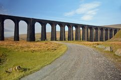 Sunny pathway at the Ribblehead Viaduct taken from western side. Sunny Morning at the Ribblehead Viaduct Yorkshire Dales National Park. View over Batty Moss and royalty free stock image