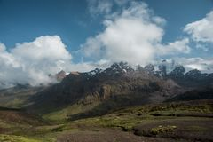 Sunny Peruvian Andes. Peruvian Andes landscape with moving white clouds by bright sunny day stock images