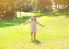 Sunny photo happy little child enjoying summer day Stock Image