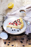 Sunny Photo with a morning breakfast in rustic style. Cheesecake raspberries and blueberries on wooden table. Stock Images
