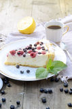 Sunny Photo with a morning breakfast in rustic style. Cheesecake raspberries and blueberries on wooden table. Stock Image