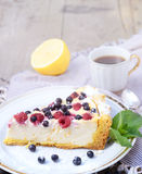 Sunny Photo with a morning breakfast in rustic style. Cheesecake raspberries and blueberries on wooden table. Royalty Free Stock Images