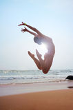 Sunny picture of jumping woman Stock Photography