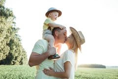 Sunny pictures of a happy family with a small child. Parents and son rest outside the city in the open air Royalty Free Stock Photo