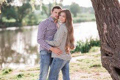 Sunny pictures of a happy married couple. Walking in park stock photo