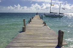 Sunny Pier with Docked Sailboat in Mexico Stock Image