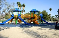Sunny playground. Playground in sun with palm trees in background Stock Image