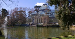 Sunny pond panorama of crystal palace buen betiro bark 4k spain stock video