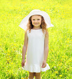 Sunny portrait of little girl child outdoors on the meadow Stock Photography