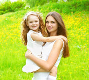 Sunny portrait of mother and daughter together having fun Royalty Free Stock Photography