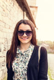 Sunny portrait of a woman with glasses Royalty Free Stock Photos