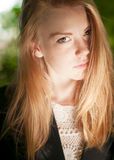 Sunny portrait of a young pretty girl  with freckles. Royalty Free Stock Photos
