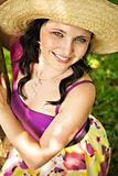Sunny portrait of young woman in straw hat Stock Images