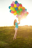Sunny and positive energy of nature. Young beautiful girl on the Royalty Free Stock Photography