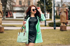 Sunny positive portrait of sexy stunning girl in short bight dress  having fun on the street, joy, happiness, weekends Stock Image