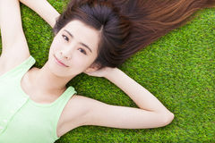Sunny pretty girl lying down on a meadow Stock Images