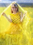 Sunny Princess. Very beautiful blue-eyed, blond girl with long hair as a sunny princess. With a glowing crown on his head and radiating a warm light, yellow royalty free stock photography