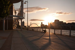 Sunny promenade in Glasgow, Scotland. Bank of the Rover Clude with the famous bridge in the background Stock Photos