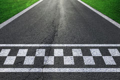Sunny race road with start and finish line. Sunny race road details with finish and start line pattern background Stock Photo