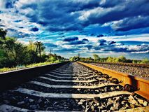 Sunny rails. Railroads and blue clouds above Stock Image