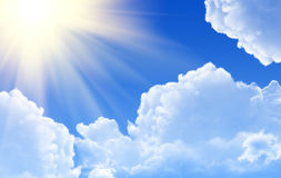 Sunny rays. In blue sky Royalty Free Stock Photography