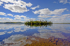 Sunny Reflections on a Clear Lake Royalty Free Stock Photos