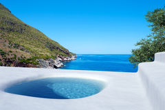 Sunny relax. Blue pool over the sea Royalty Free Stock Photos