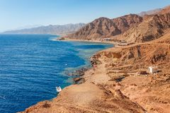 Free Sunny Resort Beach At The Coast Shore Of Red Sea In Dahab, Sinai, Egypt, Asia In Summer Hot. Famous Tourist Destination Blue Hole Royalty Free Stock Photo - 147666295