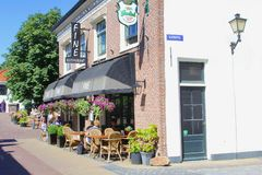 Sunny restaurant terrace people, Naarden, Netherlands. People are drinking and eating at a sunny cafe terrace in the fortress city of Naarden, Netherlands stock photo