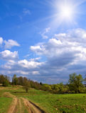 Sunny road. Summer landscape with rural way Royalty Free Stock Photos