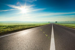 Sunny road. Beautiful sunny road in the morning royalty free stock images