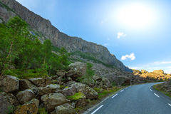 Sunny road. In the mountains valley Royalty Free Stock Photography