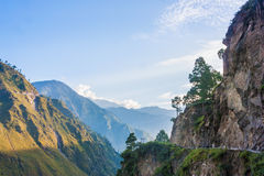 Sunny road in the mountains valley Stock Photography