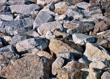 Sunny rocky background - sea defences Royalty Free Stock Images