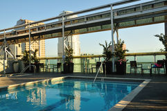 Sunny rooftop pool Royalty Free Stock Photo
