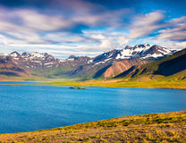 Sunny sammer morning in the Icelandic fjords. Colorful seascape near the small town Grundarfjordur, Snaefellsnes peninsula, Iceland, Europe. Artistic style Royalty Free Stock Images