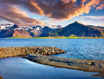 Sunny sammer morning in the Icelandic fjords. Colorful sunrise near the small town Grundarfjordur, Snaefellsnes peninsula, Iceland, Europe. Artistic style post Stock Photos
