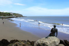 Sunny Sands beach Folkestone Kent UK. Mermaid and people relaxing on Sunny Sands Beach in Folkestone Kent UK Royalty Free Stock Images